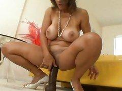 Sassy Persia Monir slides this dildo up her snatch