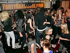 A large group of people, almost all of them girls, is dancing in a disco....