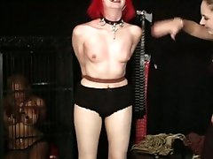 Alt girl is strung up and whipped as another slave watches