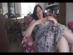 Fat older dark-haired with huge tits and ass sticks dildo in her pussy
