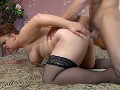 Lascivious mom lets a muscle man hike up her skirt for a from-behind...