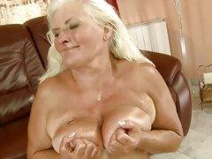 Old bitch Judi taking massive cum load all over tits