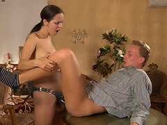 Nasty chick teases her guy with a strap-on dildo before plugging his...