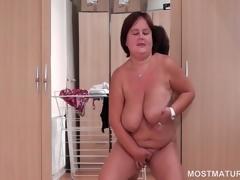 BBW mature in erotic lingerie masturbates on filigree