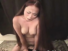 Buxom Oriental chick Kimmi rides the sybian and screams concerning respect