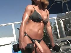 Dashing peaches pamper in a bikini enjoys pegging a fellow involving a strap on