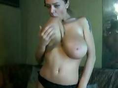 Brunette young busty harlot shows topless on web camera
